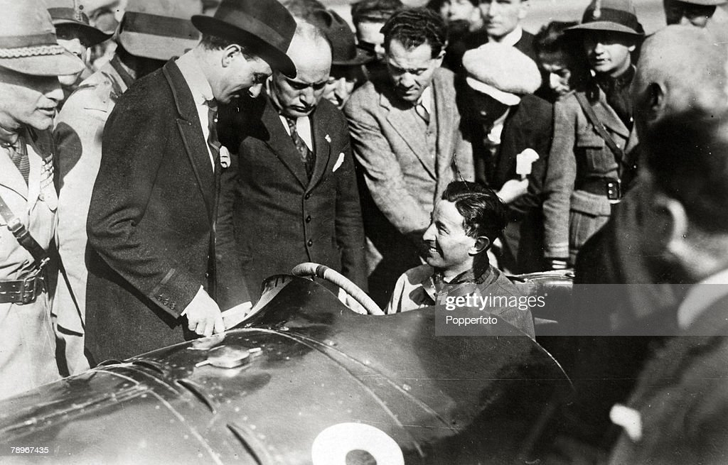 Sport. Motor Racing. The First Grand Prix of Europe at Monza, Italy. pic: 9th September 1923. Italian racing driver Pietro Bordino at the wheel chatting with Benito Mussolini. : News Photo