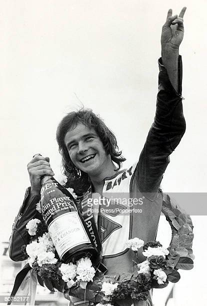 8th October 1975 British Motorcycle Grand Prix at Silverstone Barry Sheene the British champion waves from the podium after winning the 2nd leg of...