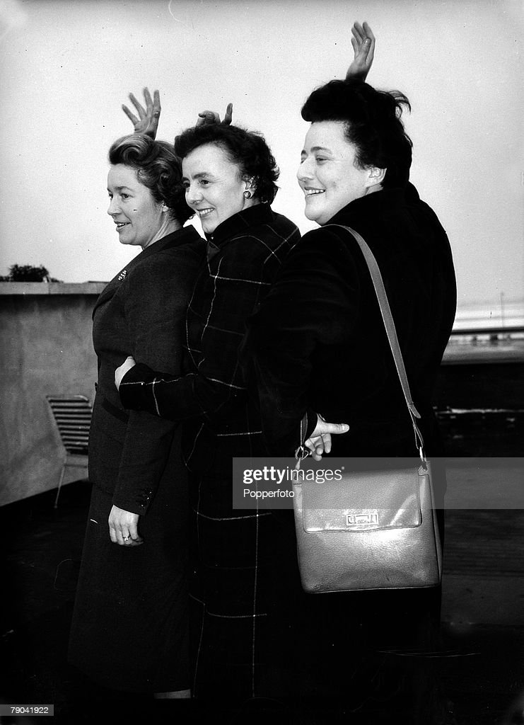 Sport. Motoring. Rally Driving. England. pic; 9th January 1956. British rally racing drivers, and reigning European Champions, Sheila Van Damm (right), her co-driver Anne Hall (centre) and new Sunbeam team-mate Yvonne Jackson leave London Airport to compe : News Photo