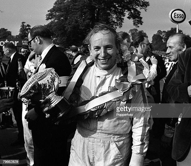 Sport MotorRacing Oulton Park Cheshire England 22nd August 1970 International Gold Cup British racing driver John Surtees poses with the trophy after...