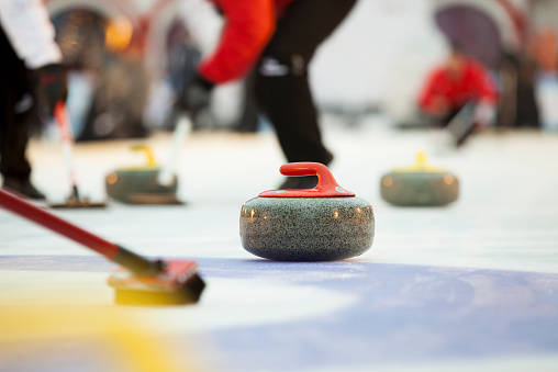 Sport of curling being played on a field 464812466