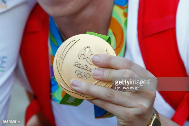 Sport, Olympics, Athlete holding gold medal from Rio games 2016.