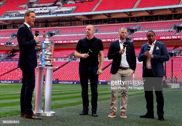 BBC Sport presenter Dan Walker with pundits Sean Dyche Eider Gudjohnsen and Paul Ince pitch side before the Emirates FA Cup Final at Wembley Stadium...