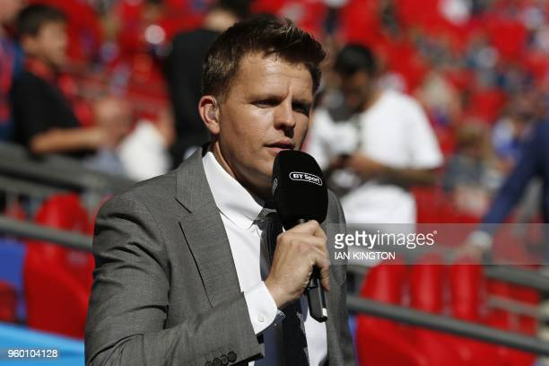 Sport presenter Jake Humphrey pitch-side ahead of the English FA Cup final football match between Chelsea and Manchester United at Wembley stadium in...
