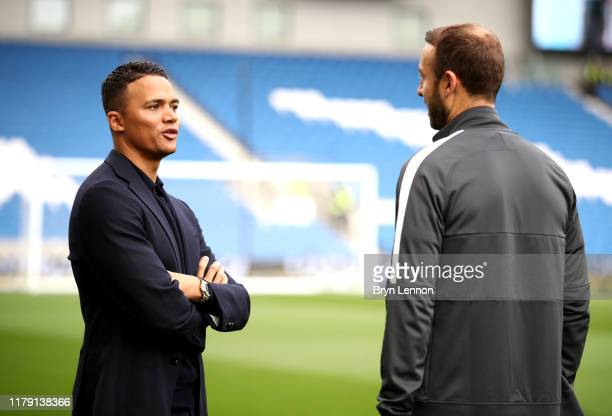 Sport presenter Jermaine Jenas speaks with Glenn Murray prior to the Premier League match between Brighton Hove Albion and Tottenham Hotspur at...