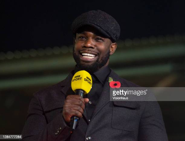Sport presenter Micah Richards talks live on the BBC before the Emirates FA Cup match between F.C. United of Manchester and Doncaster Rovers at...
