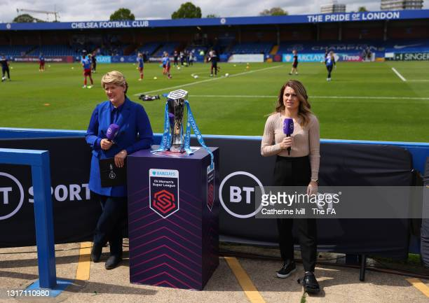 Sport presenters Clare Balding and Karen Carney speak during a TV Broadcast whilst stood next to the trophy prior to the Barclays FA Women's Super...