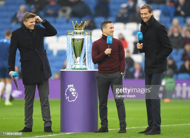Sport presenters Jake Humphrey Joe Cole and Peter Crouch look on prior to the Premier League match between Brighton Hove Albion and Chelsea FC at...