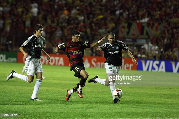 Sport Recife player Ciro fights for the ball with Edmilson during their Libertadores Cup match at Ilha do Retiro Stadium on April 8 2009 in Recife...