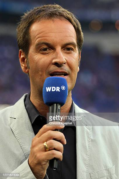Sport reporter Claus Lufen of WDR television channel speaks prior to the UEFA Europa League play-off second leg match between FC Schalke and HJK...
