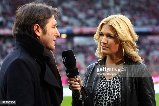 Sport reporter Jessica Kastrop talks to head coach Bruno Labbadia of Hamburg before the Bundesliga match between FC Bayern Muenchen and Hamburger SV...
