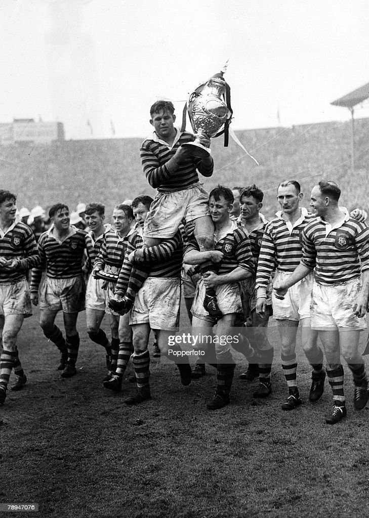 Sport. Rugby League. pic: May 1950. The Warrington captain Harry Bath is chaired by team-mates as he holds the Rugby League Challenge Cup afterWarrington had beaten Widnes 19-0 in the Rugby League Final at Wembley. : News Photo