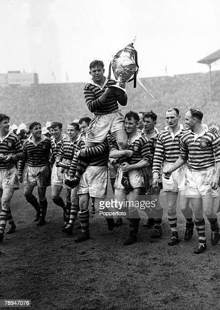 May 1950 The Warrington captain Harry Bath is chaired by teammates as he holds the Rugby League Challenge Cup afterWarrington had beaten Widnes 190...