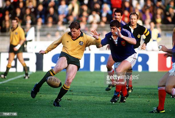 11th November 1989 International Match in Lille France v Australia Australia scrum half Nick FarrJones kicks the ball upfield