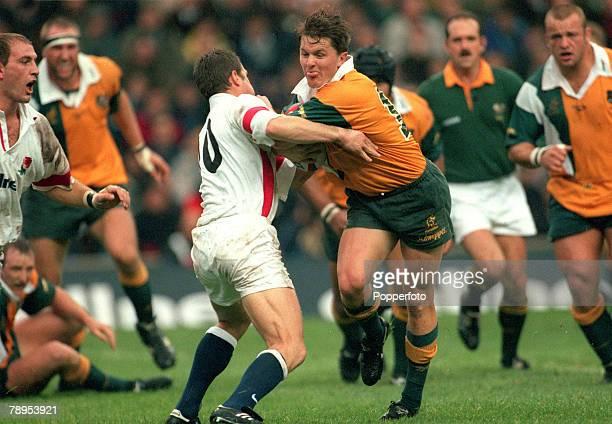 15th November 1997 International Match at Twickenham England 15 v Australia 15 Elton Flatley Australia is held by England's Mike Catt