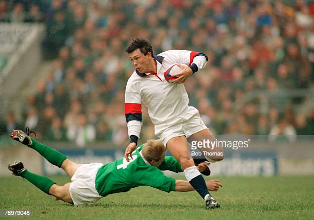 16th March 1996 5 Nations Championship at Twickenham England 28 v Ireland 15 England wing Rory Underwood avoids a diving tackle from Ireland's Simon...