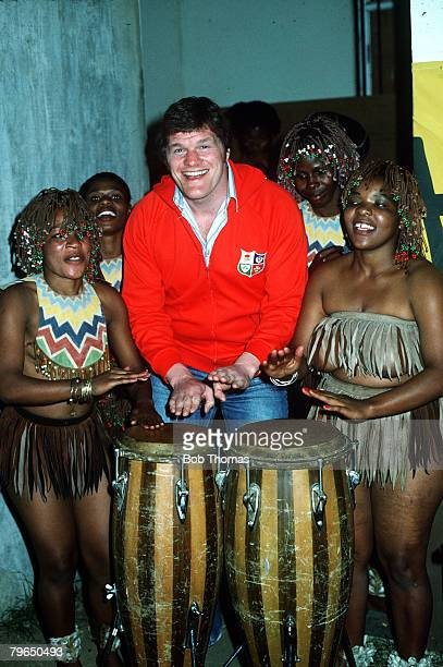 1980 British Lions tour to South Africa Fran Cotton the British Lions forward enjoying himself playing the African drums helped by native girls