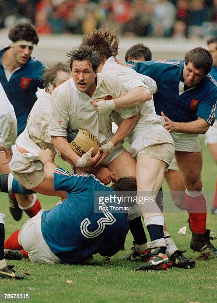 3rd February 1990 5 Nations Championship in Paris France 7 v England 26 England's Mike Teague holds on to the ball as France's Jean Pierre Garuet...