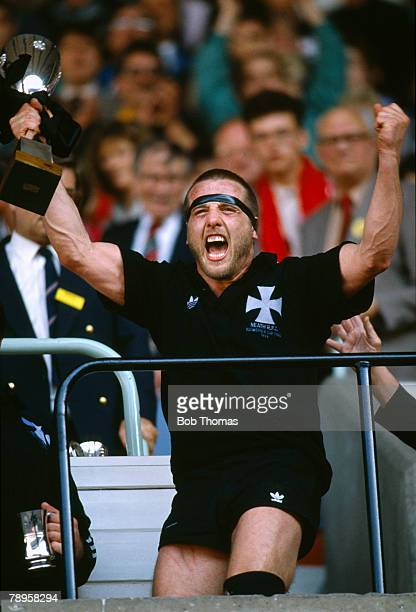 6th May 1989 Schweppes Welsh Cup Final Cardiff Llanelli 13 v Neath 14 Neath's Kevin Phillips shows his excitement as he celebrates with the trophy