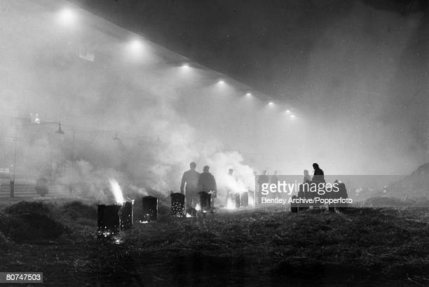 February 1956 Cardiff Some of the 60 braziers on the pitch in Cardiff in a successful attempt to thaw out the pitch before the Wales v Scotland clash...