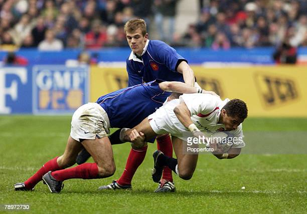 Sport Rugby Union Six Nations Paris France 2nd March 2002 France 20 v England 15 England's Jason Robinson is tackled by France's Tony Marsh Aurelien...