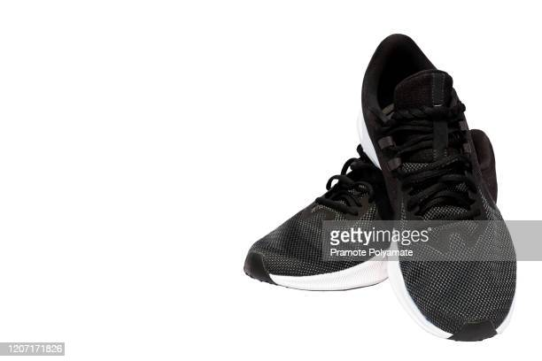 sport shoes isolated on white background - gray shoe stock pictures, royalty-free photos & images
