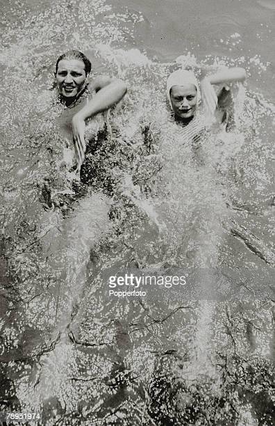 circa 1930's The 1932 Olympic Games Gold medalists for the Mens/Womens 100 metres Backstroke George Kojac USA and Eleanor Holm USA practice for the...