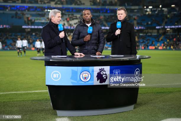 Sport television presenter Matt Smith works pitchside with pundits Nedum Onuoha and Steve McManaman before the Premier League match between...