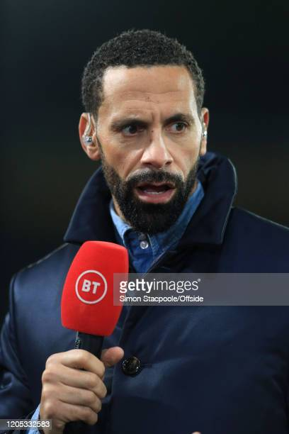 Sport television pundit Rio Ferdinand holds the microphone during the FA Cup Fifth Round match between Derby County and Manchester United at Pride...