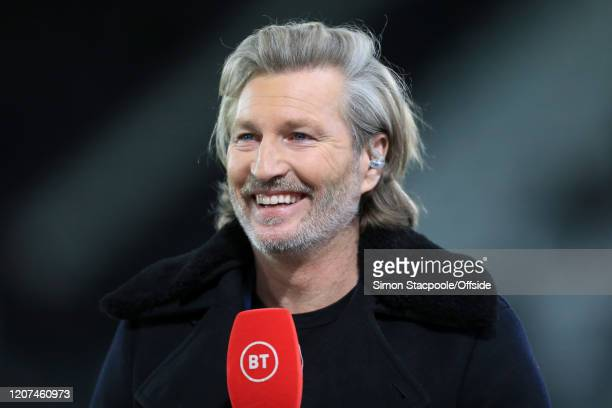 Sport television pundit Robbie Savage holds the microphone during the FA Cup Fifth Round match between Derby County and Manchester United at Pride...