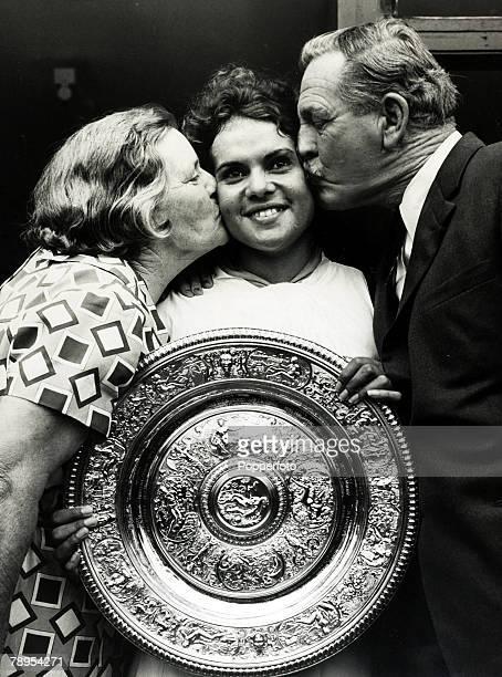 July 1971 Wimbledon Lawn Tennis Championships Ladies Singles Final Australia's Evonne Goolagong gets a congratulatory kiss from her coach Vic Edwards...