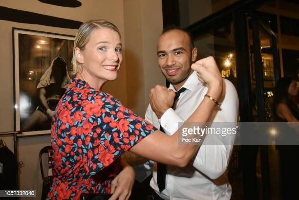 Sport TV presenter France Pierron from L Equipe 21 and Karateka champion Djema Belkhodja attend the 'Champion Spirit' Rive Gauche Launch Party at...