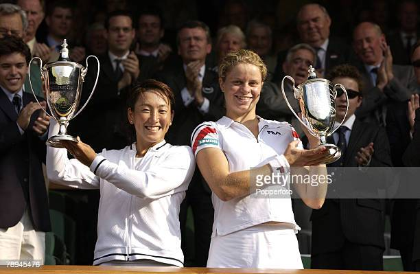 Sport Wimbledon Lawn Tennis Championships London England 6th July 2003 Ladies Doubles Final Kim Clijsters of Belgium and Sugiyama of Japan hold aloft...