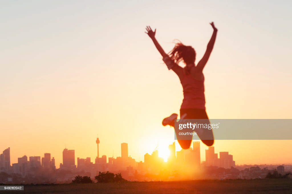 Sport women jumping and celebrating with arms raised. : Stock Photo