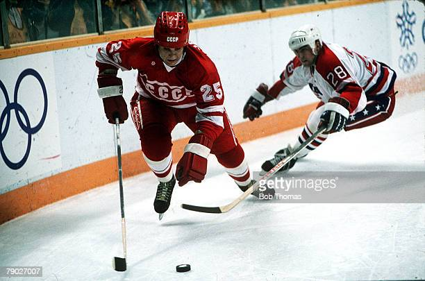 Sport XXIV Winter Olympic Games Calgary Canada 17th February 1988 Ice Hockey USSR 7 v USA 5 Russia's Serguei Jachine moves past USA's Stephen Leach