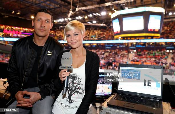 Sport1 handball expert Stefan Kretzschmar and sport1 tv presenter Anett Sattler look on before the Rewe Final Four final match between SG...