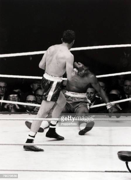 Sport/Boxing Wembley London England 18th June 1963 Heavyweight Fight American heavyweight Cassius Clay is put down by British Champion Henry Cooper...