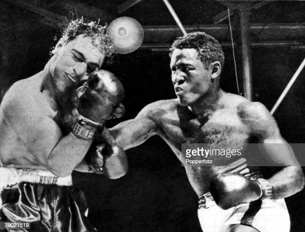 Sport/Boxing World Heavyweight Championship Yankee Stadium New York 17th June 1954 Ezzard Charles lands a hard right hand punch as Rocky Marciano...