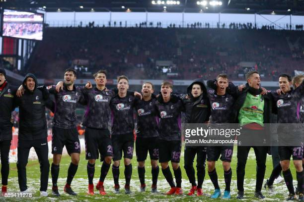 SportClub Freiburg players celebrate after the Bundesliga match between 1 FC Koeln and SportClub Freiburg at RheinEnergieStadion on December 10 2017...