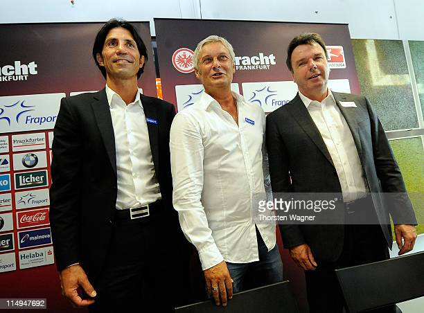 Sportdirector Bruno Huebner, Armin Veh and ceo Heribert Bruchhagen pose after the presentation of Armin Veh as new head coach at Commerzbank Arena on...