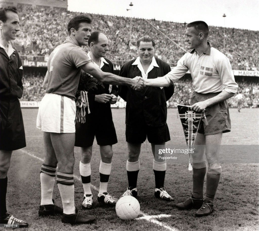 Sport/Football. 1958 World Cup Final. Stockholm. 29th June 1958. Sweden 2 v Brazil 5. The Brazil captain Bellini (left) greeted by Sweden captain Nils Liedholm before the final as the match officials look on. : News Photo