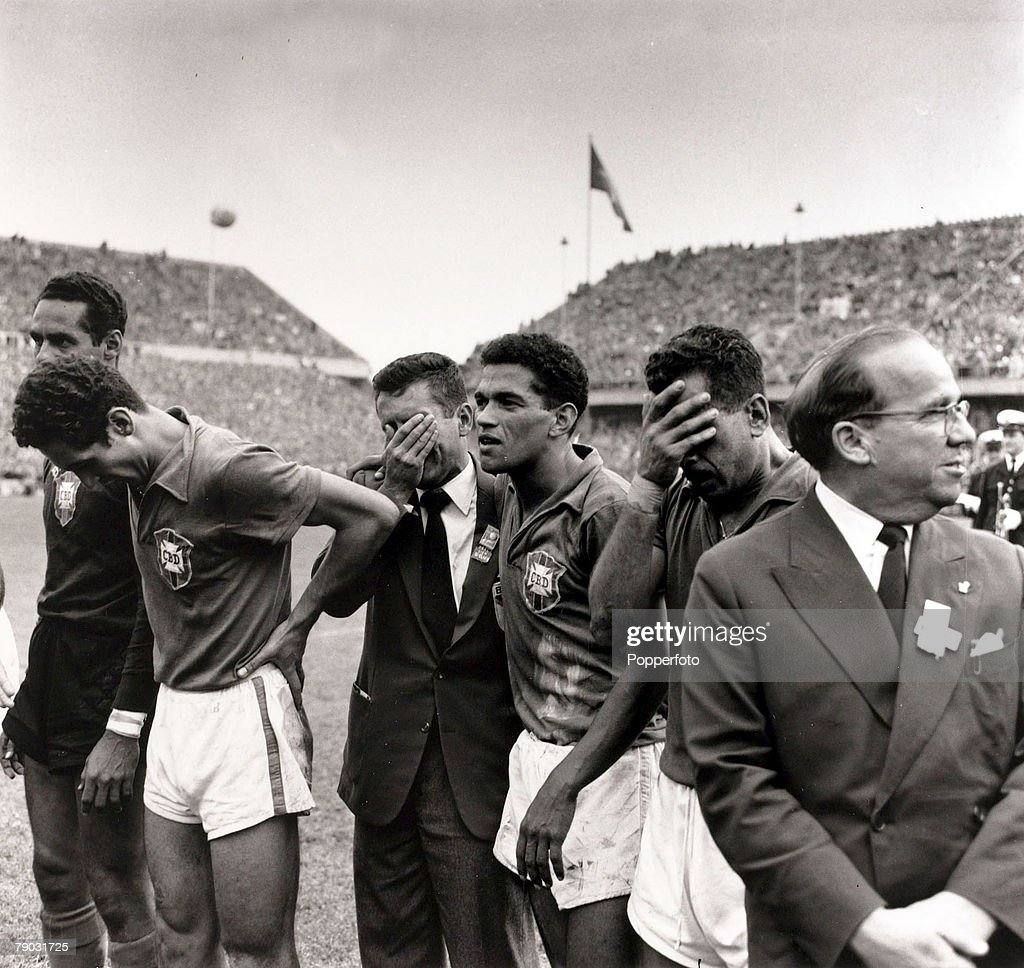 Sport/Football. 1958 World Cup Final. Stockholm. 29th June 1958. Sweden 2 v Brazil 5. The Brazil team members some overcome with emotion line up with officials after their victory, L-R: Gilmar, unknown, Garrincha and Zito. : News Photo