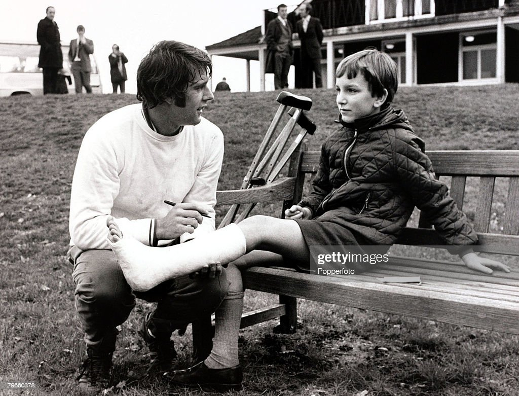 Sport/Football, 24th November 1970, England Training, Roehampton, West Ham United's Geoff Hurst signs a little boy's plaster after England training for the friendly international match v East Germany at Wembley : News Photo