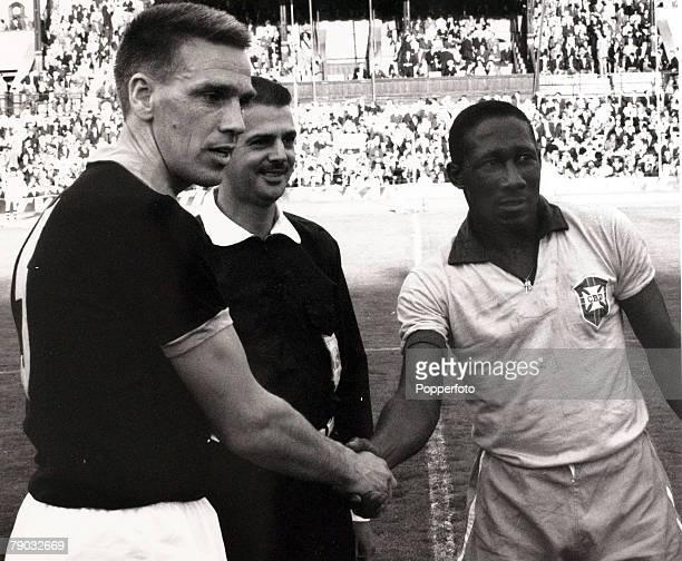 Sport/Football Brazil tour of Europe Sweden 4th July 1966 AIK 1 v Brazil 3 Brazil captain Djalma Santos shakes hands with the AIK captain before a...