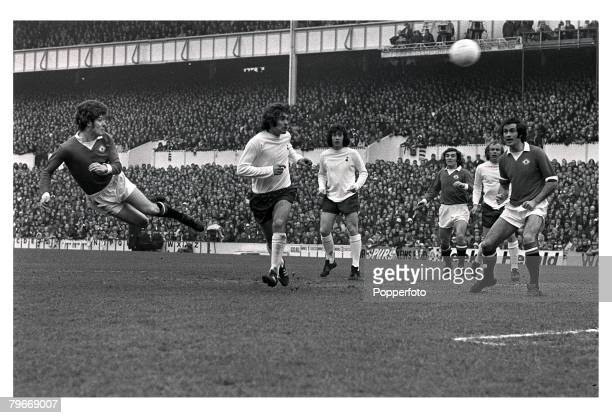 SportFootball Brian KIdd of Manchester United heads for goal watched by Mike Dillon and Joe Kinnear of Tottenham hotspur Lou Macari Phil Beal George...