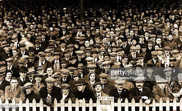 Sport/Football Brighton and Hove Albion v West Ham United circa 1920 A sea of faces in the crowd most wearing headwear caps and hats the numbered...