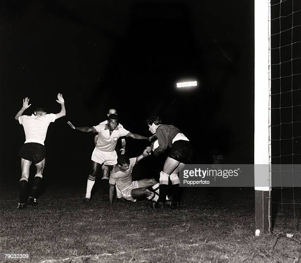 Sport/Football Copa America South American Championship Buenos Aires Argentina 26th March 1959 Brazil 3 v Uruguay 1 Brazil's Chinezinho helped to his...