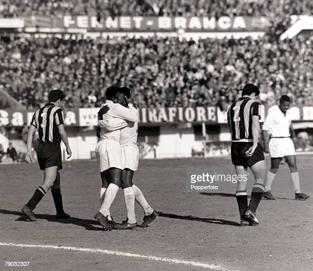 Sport/Football Copa Libertadores South American Club Championship 30th August 1962 Santos 3 v Penarol 0 Santosand Brazil star Pele is hugged by a...