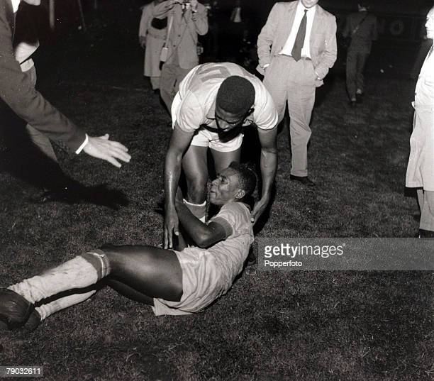 Sport/Football in South America South American Championship Buenos Aires 26th March 1959 Brazil 3 v Uruguay 1 Brazil's Pele grounded is helped up by...
