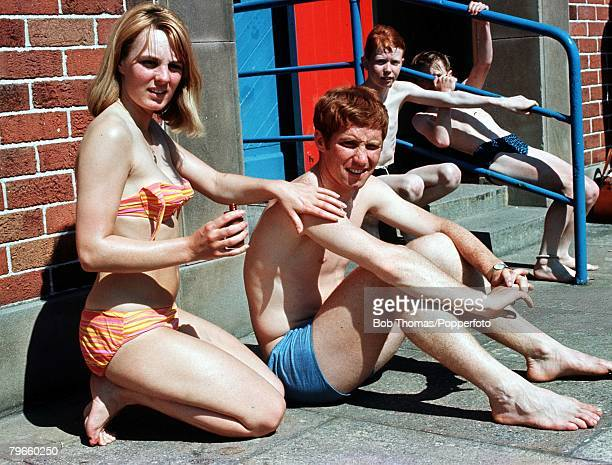 Sport/Football July 1966 Everton and England footballer Alan Ball relaxes with his wife Lesley at a Southport lido
